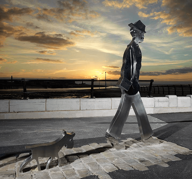Lowry Sculpture Man and His Dog Sunset
